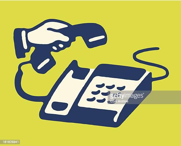 Man Lifting Handset of Keypad Telephone