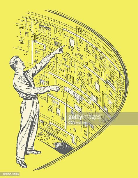 Man Looking at Diagram