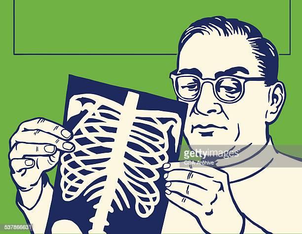 Man Looking at X-Ray