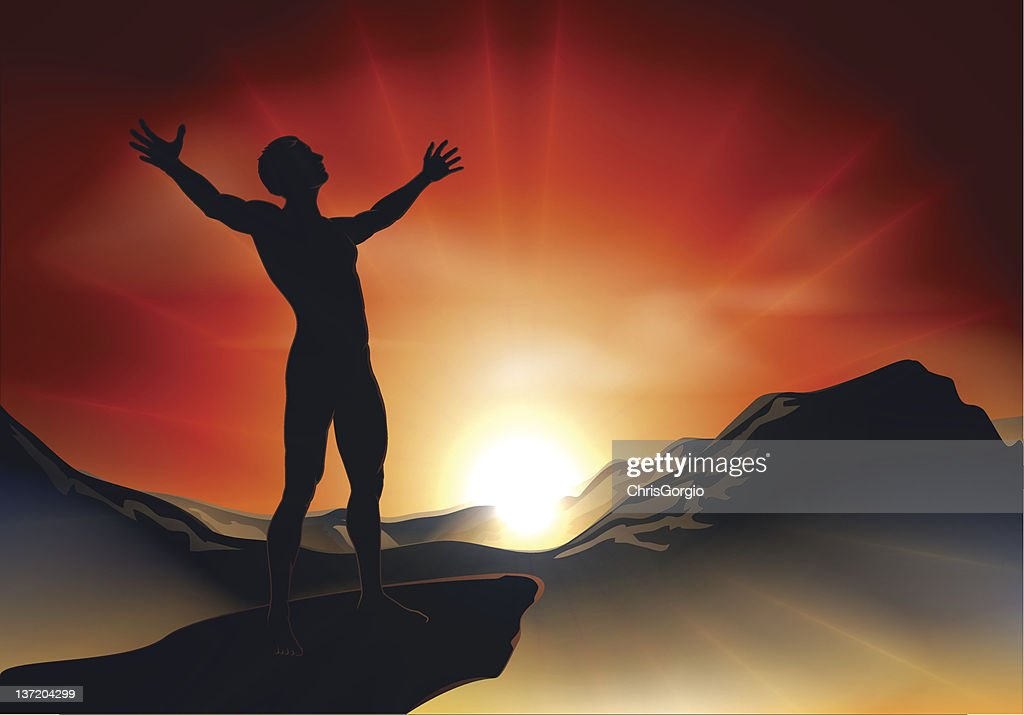 Man on mountaintop with arms out