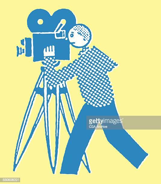 Man Operating Movie Camera