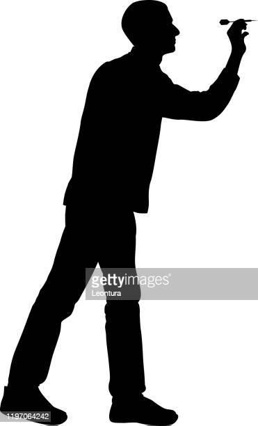 man playing darts - dart stock illustrations
