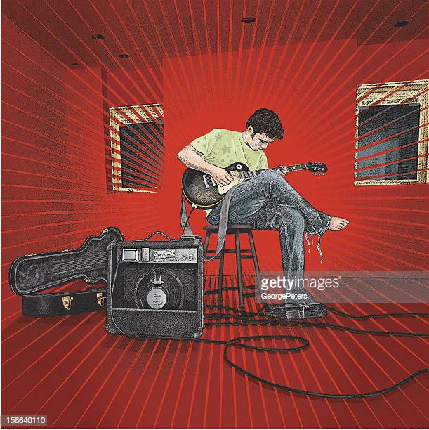Man Playing Guitar in Red Room with Amp
