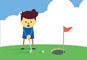 Man putting a golf ball into the big hole.