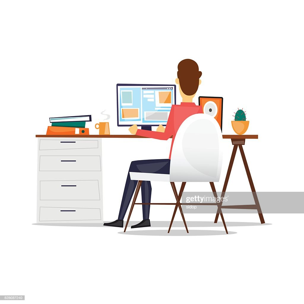 Man sitting at a desk and working on the computer.