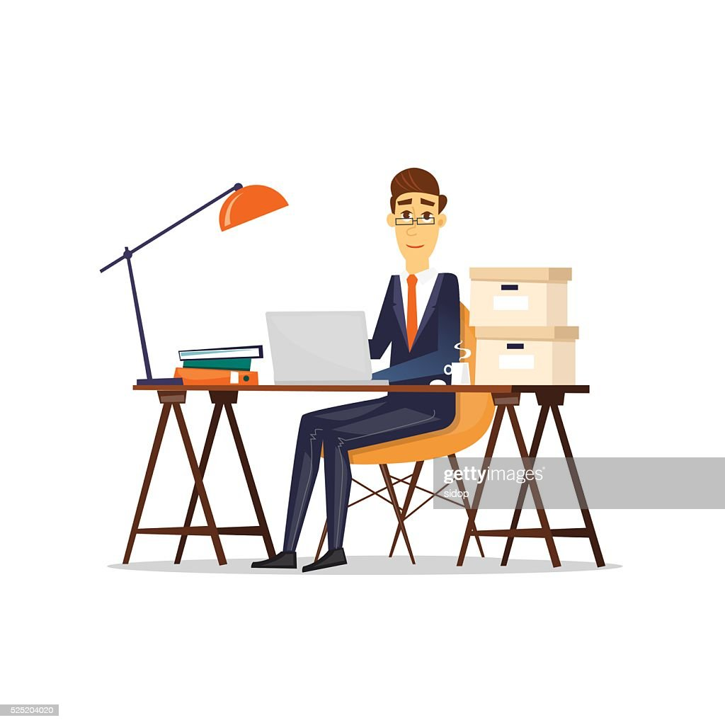 Man sitting at the table and working on a computer.