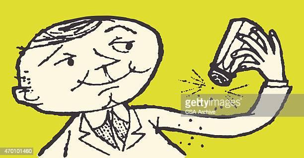 Man Sprinkling Salt