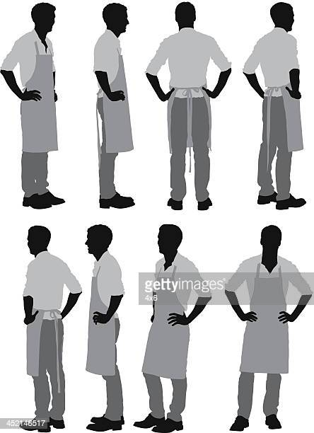 man standing in apron - apron stock illustrations