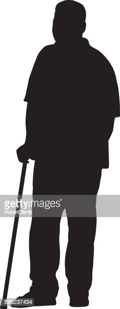 man standing with cane silhouette - walking cane stock illustrations