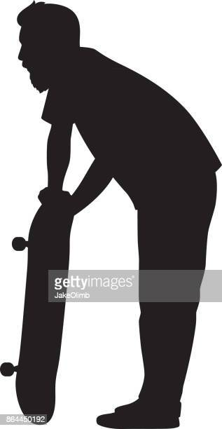 Man Standing with Skateboard Silhouette