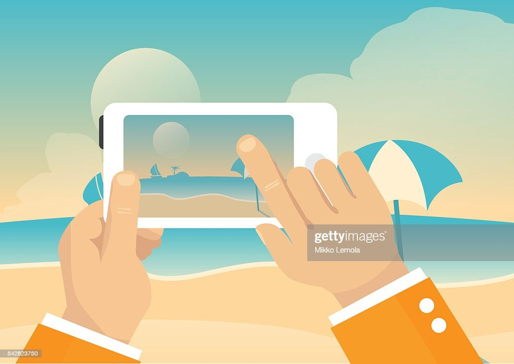 Man taking landscape photo with mobile phone - beach summer