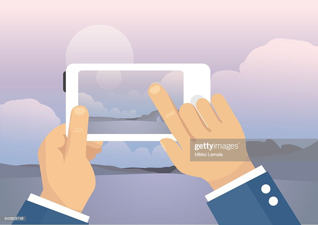 Man taking landscape photo with mobile phone - lake view