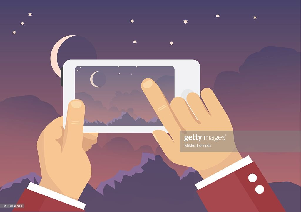 Man taking landscape photo with mobile phone - nigh sky