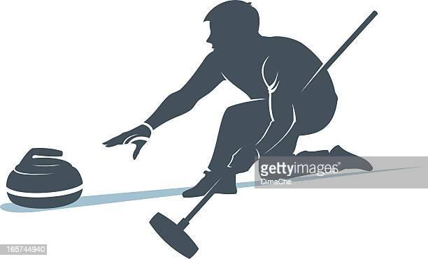 Man taking part in curling sport