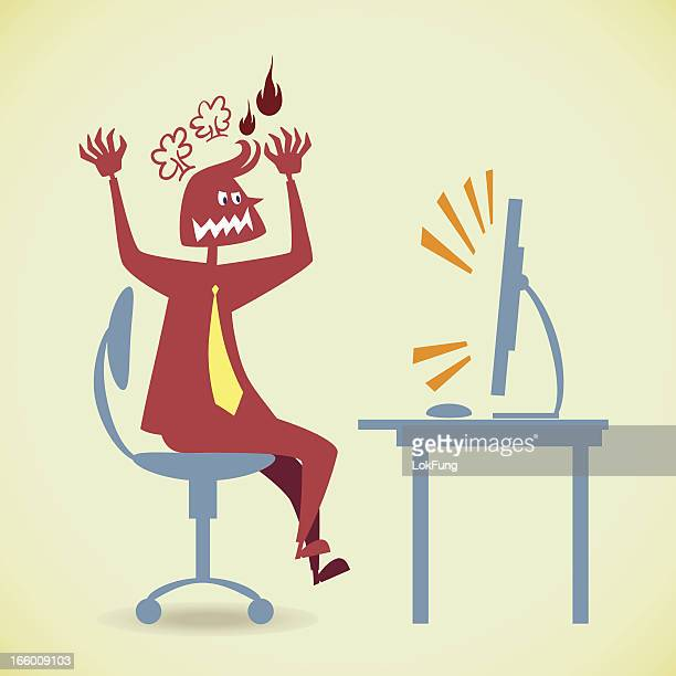 Man using computer in anger