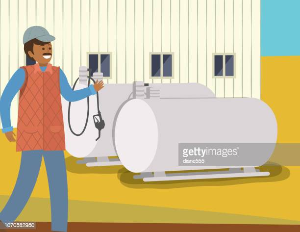 Man Walking In Front Of Propane Tanks On A Farm