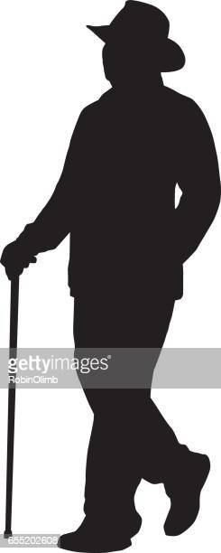 Man Walking With Cane Silhouette.