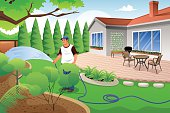 Man watering his grass and garden