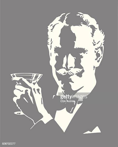 Man Wearing Bow Tie Holding Cocktail