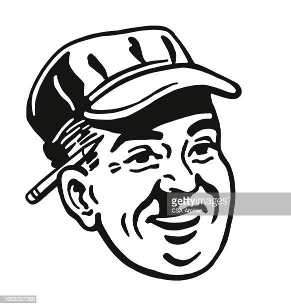 Man Wearing Cap and Pencil Behind Ear