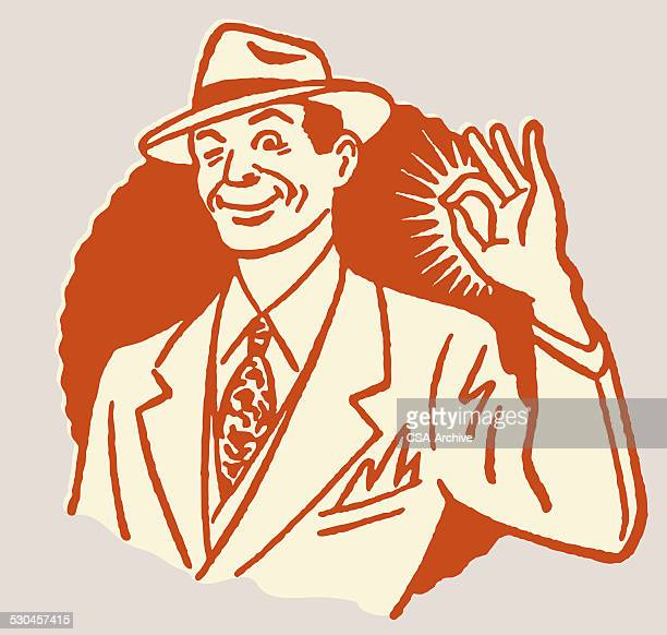 Man Winking and Making OK Gesture