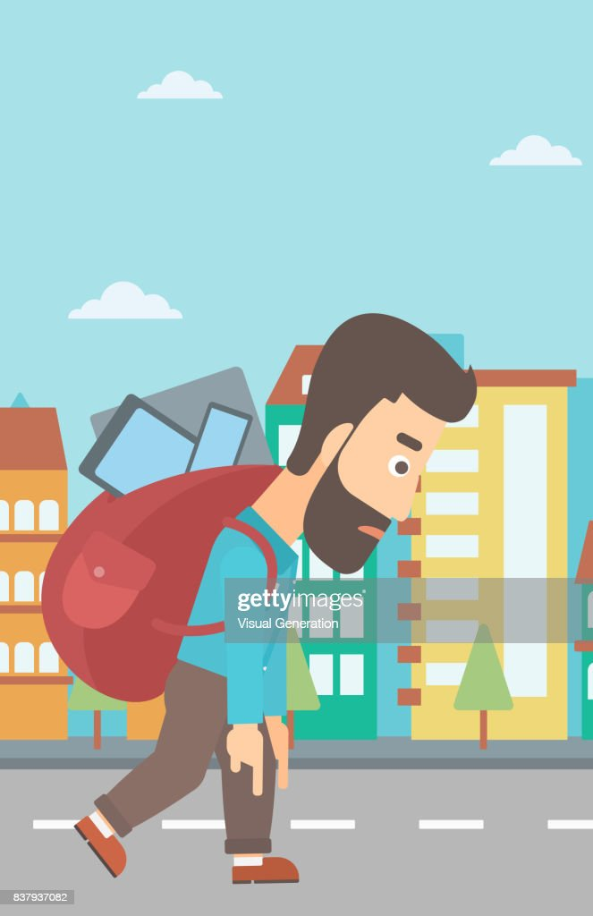 Man with backpack full of devices