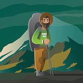 Man with big beard and backpack in the mountains.