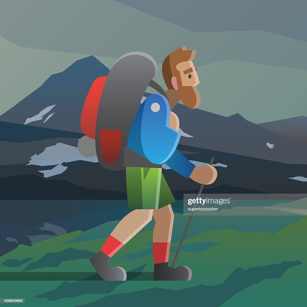 Man with big beard walking in the mountains.
