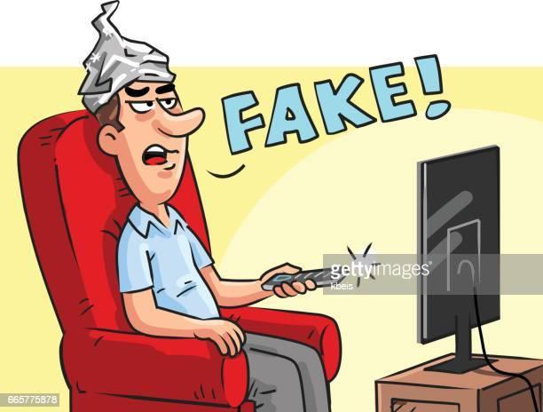 ilustraciones, imágenes clip art, dibujos animados e iconos de stock de hombre con sombrero de hoja de lata mirando noticias falsas - papel de aluminio