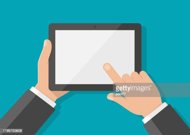 man's hand holding a tablet and touches the screen with his fingers - human body part stock illustrations