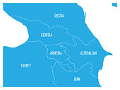Map of Caucasian region with states of Georgia, Armenia, Azerbaijan, Russia Turkey and Iran. Flat blue map with white country borders and labels