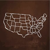USA map sketched on rusty metal background