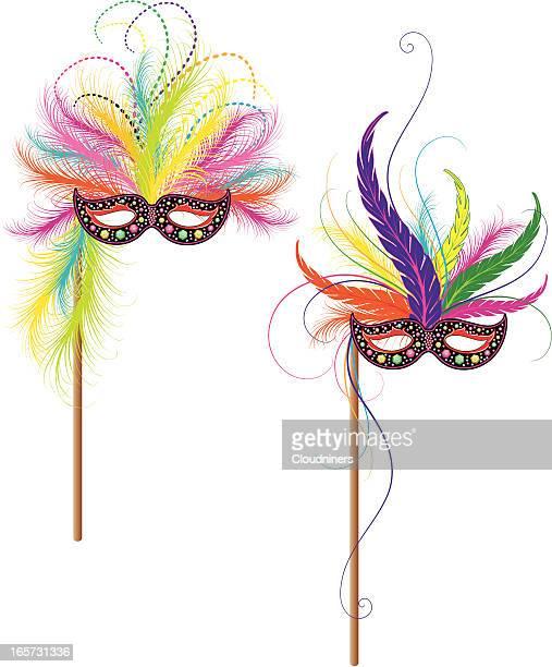 mardi gras reveler masks - stage costume stock illustrations