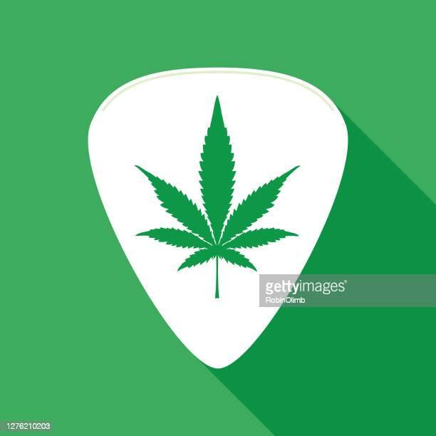 marijuana leaf guitar pick icon - marijuana leaf stock illustrations
