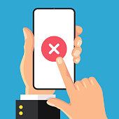 X mark on smartphone screen. Hand holding smart phone with red cross mark. Finger touching screen. Modern flat design. Vector illustration