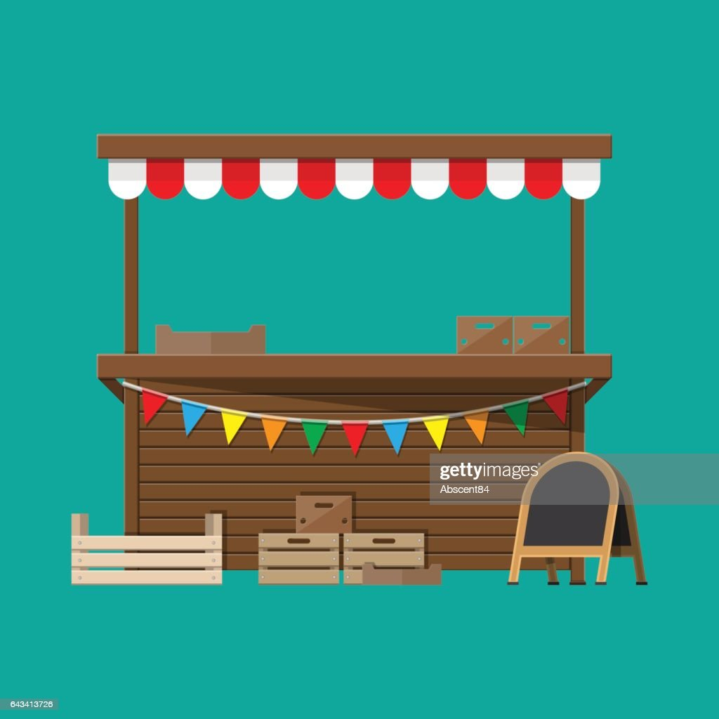 Market food stall with flags, crates, chalk board