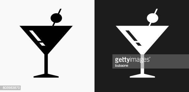 martini glass icon on black and white vector backgrounds - cocktail stock illustrations