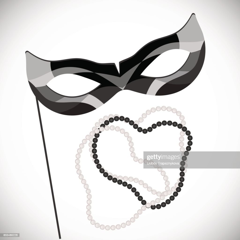 Masquerade mask on a stick. Black and white pearl necklace. Mardi Gras
