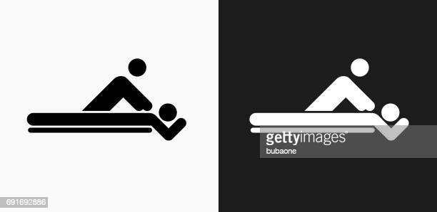 massage icon on black and white vector backgrounds - clip art stock illustrations, clip art, cartoons, & icons