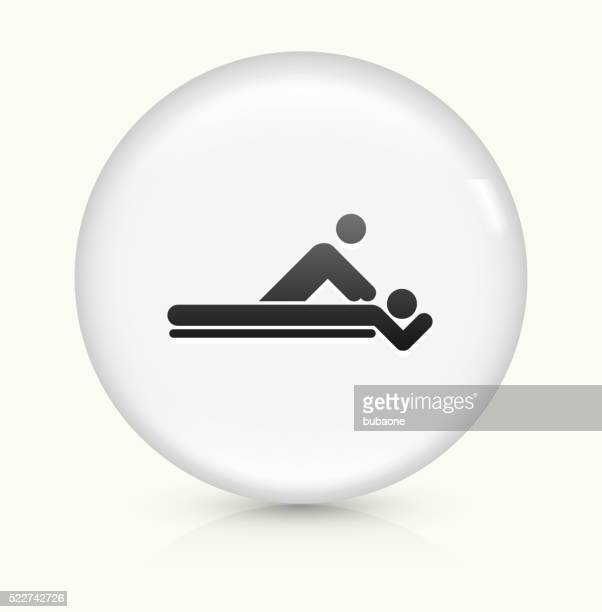 massage icon on white round vector button - physical therapy stock illustrations, clip art, cartoons, & icons
