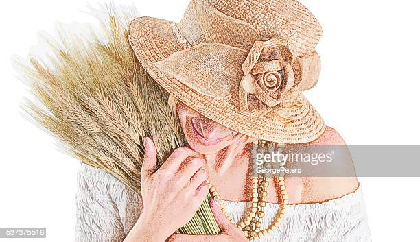 Mature Woman hugging bundle of dried wheat