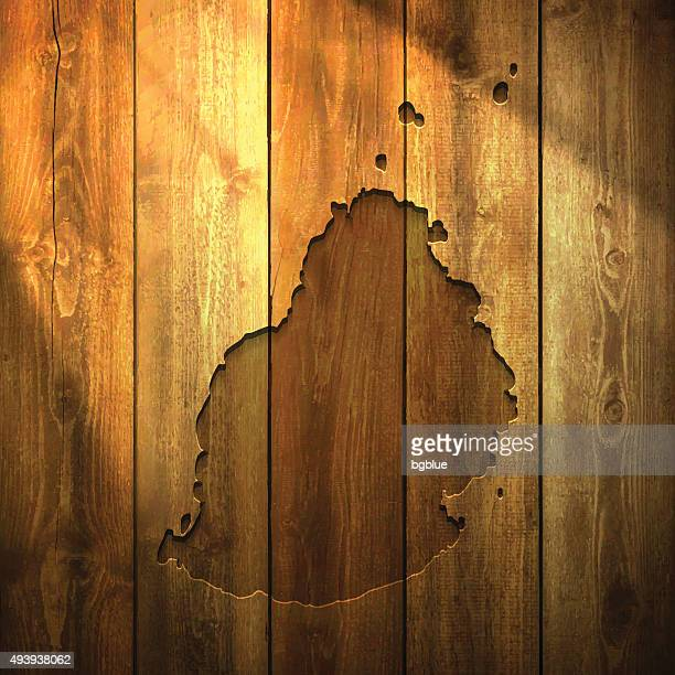 Mauritius Map on lit Wooden Background