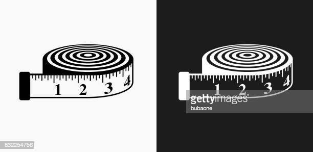 measurement tape icon on black and white vector backgrounds - tape measure stock illustrations