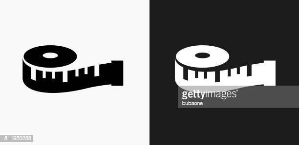 measuring tape icon on black and white vector backgrounds - length stock illustrations