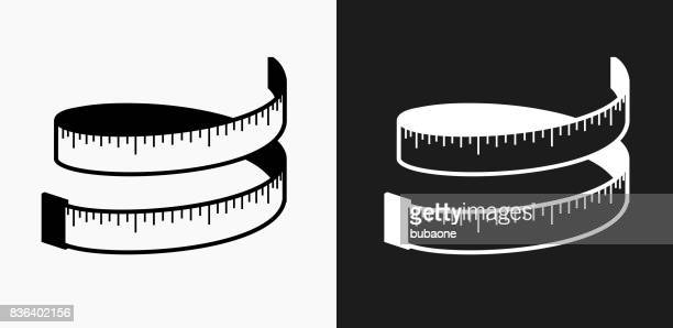 measuring tape icon on black and white vector backgrounds - tape measure stock illustrations, clip art, cartoons, & icons