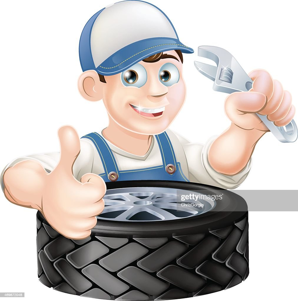 Mechanic with spanner and tire