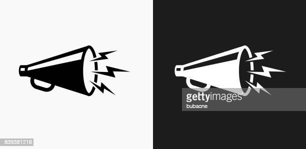 megaphone icon on black and white vector backgrounds - megaphone stock illustrations