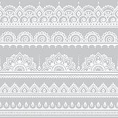 Mehndi, Indian Henna tattoo seamless white pattern on grey background