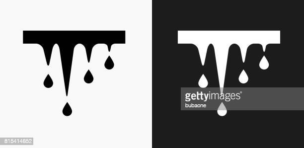 melting icicles icon on black and white vector backgrounds - icicle stock illustrations