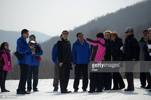 Members of the The International Olympic Committee's Evaluation Commission and representatives of Beijing's 2022 Winter Olympics bid committee tour a...